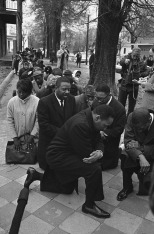 Dr. Martin Luther King Jr., center, leads a group of civil rights workers and Selma black people in prayer on Feb. 1, 1965 in Selma, Alabama after they were arrested on charges of parading without a permit. More than 250 persons were arrested as they marched to the Dallas County courthouse as part of a voter registration drive. (AP Photo/BH)